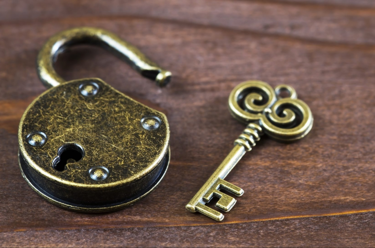 Escape room concept, vintage golden key and opened padlock, web banner with copy space